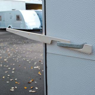 Okenné úchyty na sušiak na bielizeň